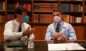 A grab from a video made available by official account of the president of Brazil, Jair Bolsonaro, which shows Bolsonaro (right), and the minister of health, Luiz Henrique Mandetta