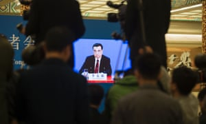 Li Keqiang is shown on a screen during a press conference