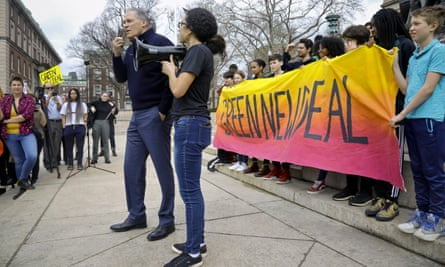 Democratic presidential candidate Washington governor Jay Inslee, center, address a student Climate Strike rally at Columbia University on 15 March in New York.