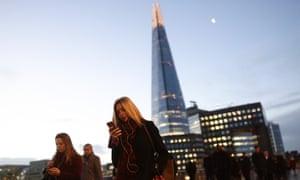 City workers walking across London Bridge.