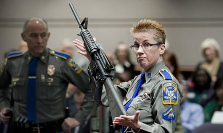 A Connecticut detective holds up a Bushmaster AR-15 rifle, the same make and model of gun used by Adam Lanza in the Sandy Hook school shooting.
