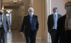 Mitch McConnell walks to the Senate chamber on Thursday.