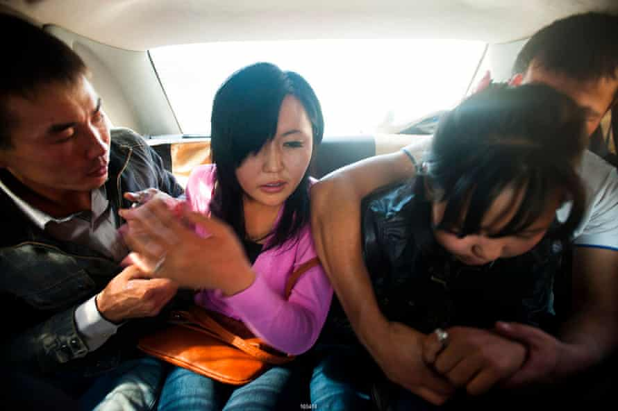 One victim of ala kachuu was Farida, 20. Here she is seen struggling after being forced, with a friend (right), into the back of a car.