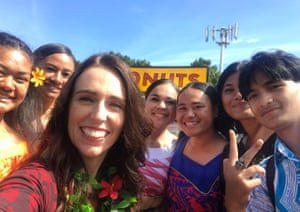 Jacinda Ardern with a group of people