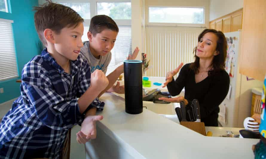 Amazon Alexa smart speaker in kitchen with children and mother