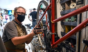An employee works in a bicycle repair shop in Lille, northern France, after the government announced subsidies for bike repairs aimed at easing public transport crowds during the coronavirus outbreak.
