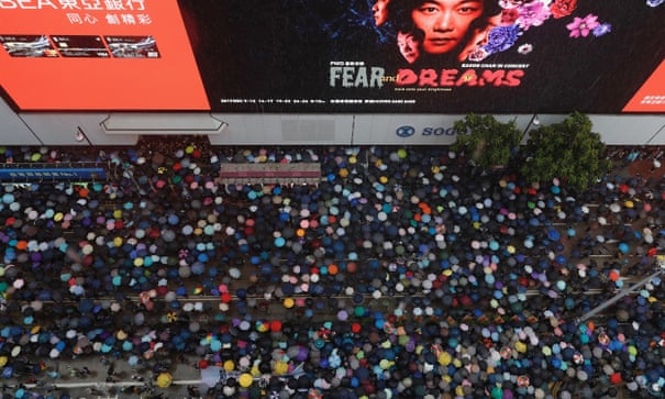 Hong Kong: 1.7m people defy police to march in pouring rain