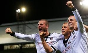 Pajtim Kasami (left) celebrates with Fulham teammates Steve Sidwell and Dimitar Berbatov.