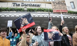 Protesters gather outside the Dorchester hotel in London.