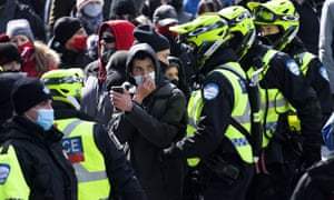 Police remove a man from a demonstration opposing government restrictions to curb the spread of Covid-19 in Montreal on Saturday.