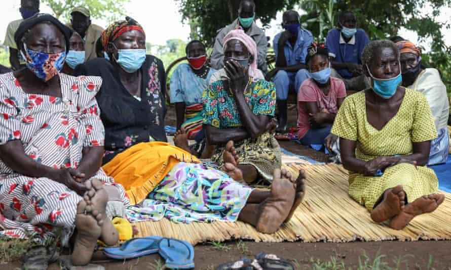 Residents of Lukodi village in Uganda listen to the sentencing of Dominic Ongwen.
