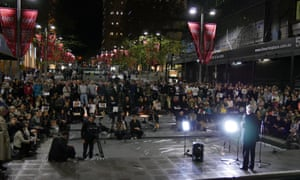 People gather to hold a vigil at Martin Place in Sydney.