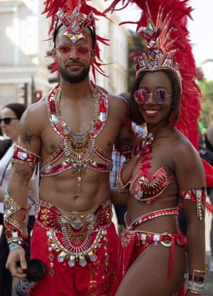 Colourful masquerade dancers at the Notting Hill carnival