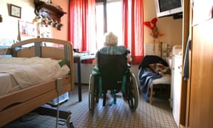 A woman in a wheelchair at a care home