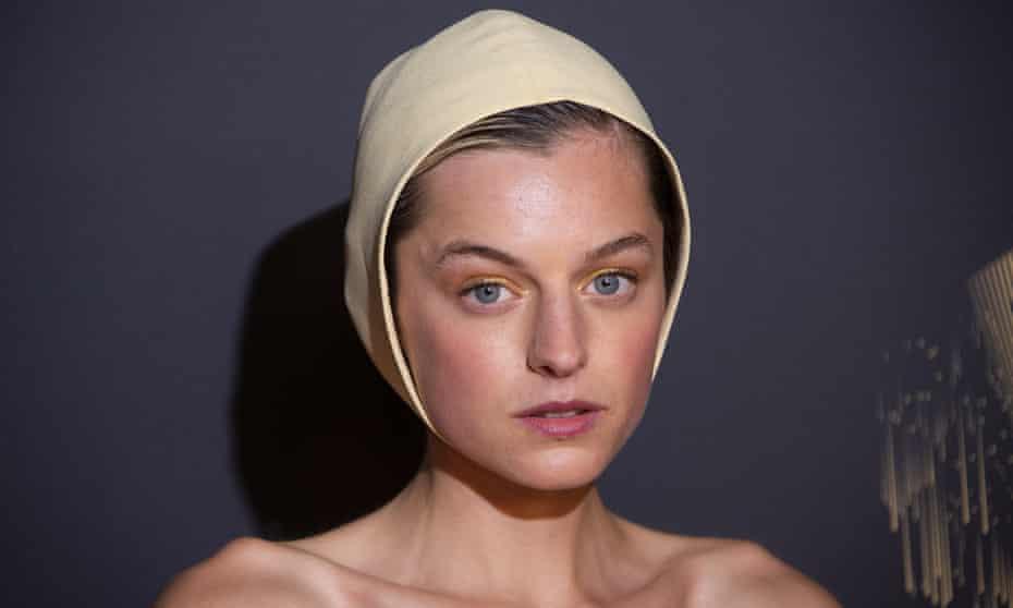 Emma Corrin in their beige swimming-cap-style headgear