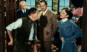 Stanley Holloway, second left, as Alfred Doolittle in My Fair Lady.