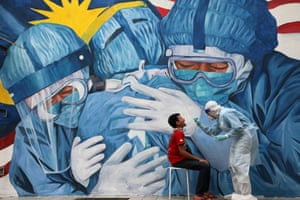 Shah Alam, Malaysia. A doctor collects a swab sample outside a clinic