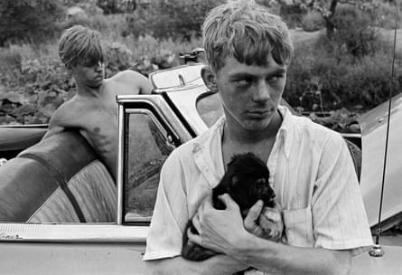 'I gave them a dollar to get the car going' … Boy With Puppy, Knoxville, Tennessee, 1967.