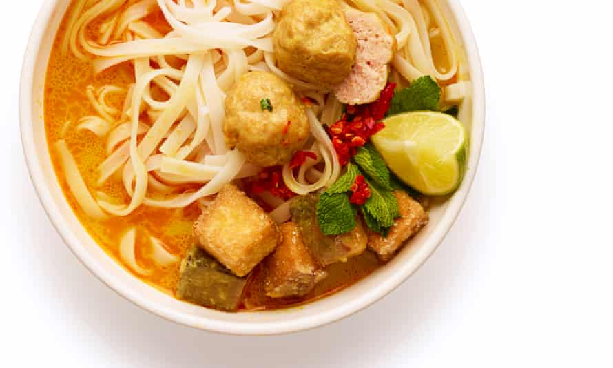 Ladle the broth over cooked rice noodles, top with the tofu, prawn balls and herbs, and serve with lime and chilli.