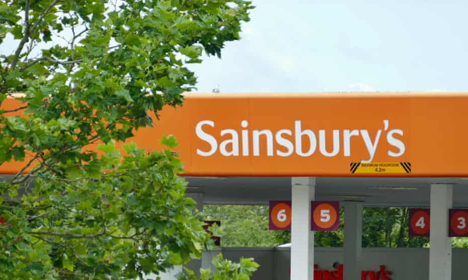 sainsbury's sign with tree in foreground