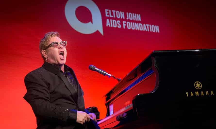 Sir Elton John performs at his Aids benefit concert, An Enduring Vision, in New York.