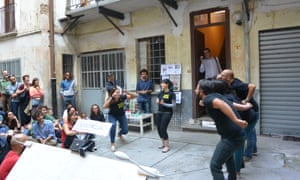 A theatre troupe perform in the courtyard.