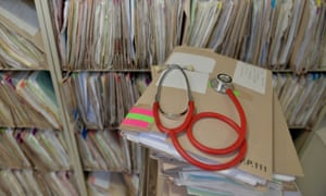 A stethoscope on top of patient's files