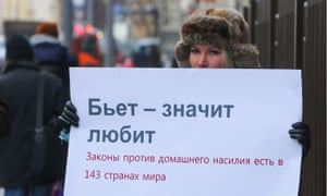 Alena Popova, a Russian human rights activist, holds a banner protesting against the Russian bill
