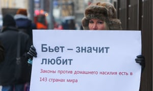 A lone woman protests in Moscow against the decriminalisation of domestic violence.