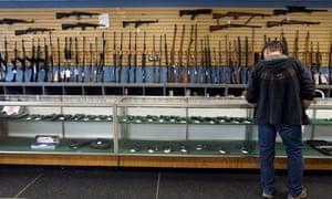 man at gun store