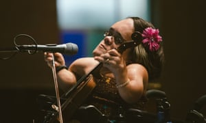 Haunting melodies and protest songs … Gaelynn Lea with the violin she plays like a cello.
