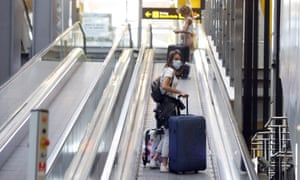 Travellers arriving at the Adolfo Suárez Madrid-Barajas airport on Sunday.