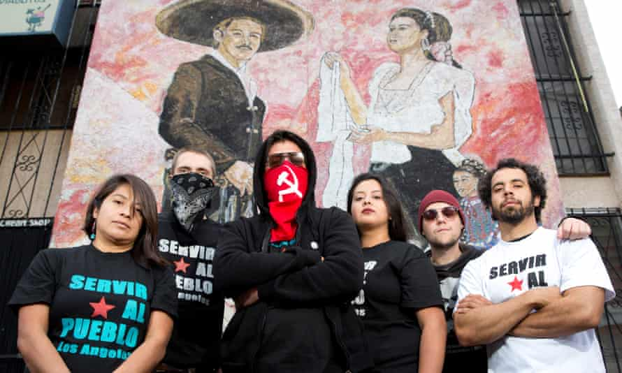 Servir al Pueblo (Serve the Town) activists in Boyle Heights, east Los Angeles, left to right: Lupe, Alex, Facundo, EJ, Diana, Daniel in Mariachi Plaza.