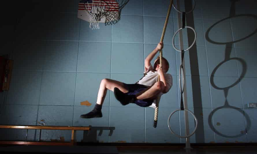 child on ropes in school gym