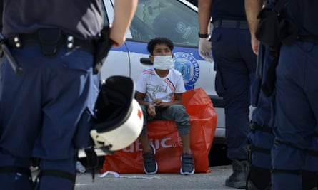 A boy waits to leave Lesbos