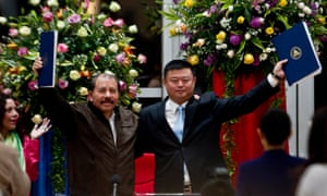 Wang Jing (right) of HKND pictured with Nicaraguan president Daniel Ortega and the agreements for the construction of the interoceanic canal in 2013. HKND has invested more than 3bn yuan in the project.