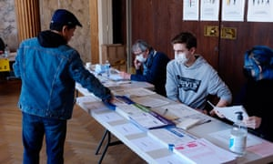 Hand sanitizers are seen in a polling station during the first round of municipal elections in France