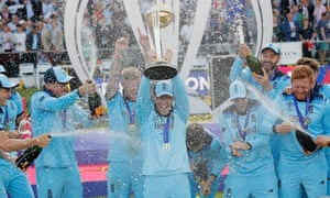 England celebrate with champagne after Eoin Morgan lifted the World Cup trophy.