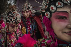 Beijing, ChinaChinese dancers wear costumes after performing at a fair on the second day of the Chinese Lunar New Year