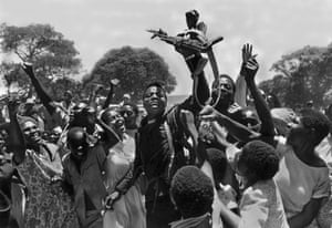 A freedom fighter, from one of the anti-government forces, enters the town of Mutoko, Rhodesia and is given a hero's welcome as the war comes to an end, December 1979.