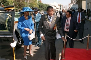 2003Mugabe and his wife Grace arrive for the ceremonial opening of parliament in central Harare in 2003