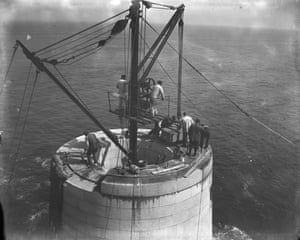 The construction of the Fastnet lighthouse, 1902. Remarkably, one man – master mason James Kavanagh (in the white jacket on the circular ledge) – placed every stone of the lighthouse with his bare hands.