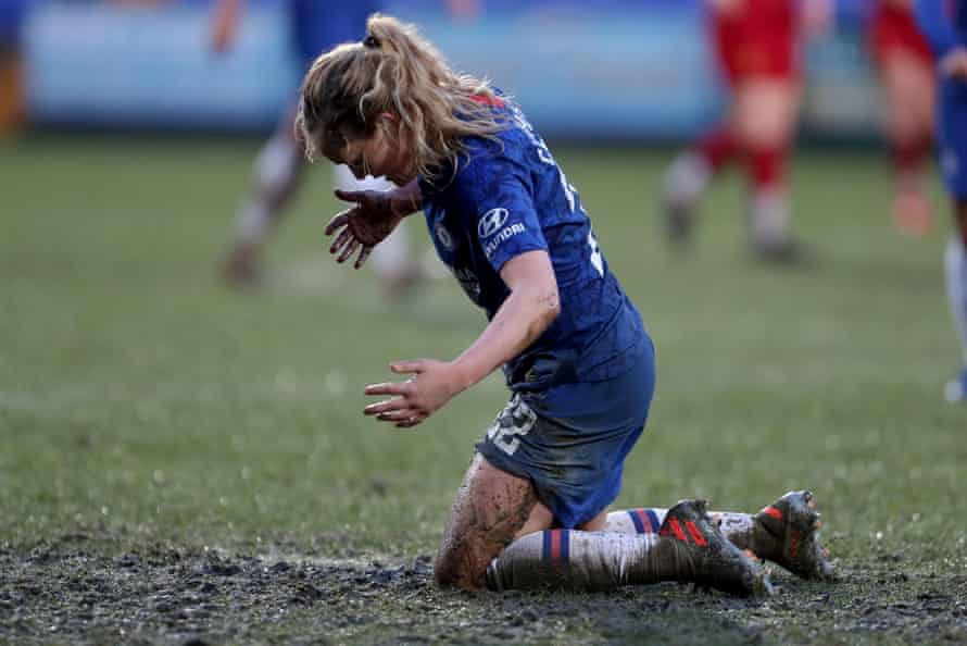 Chelsea's Erin Cuthbert suffers in the mud at Prenton Park