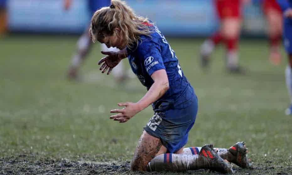 Chelsea's Erin Cuthbert braves the mud at Prenton Park.