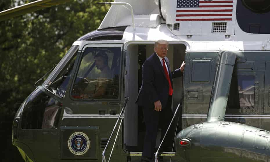 Donald Trump looks back as he boards Marine One on the South Lawn of the White House on Saturday.