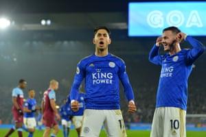 Ayoze Perez of Leicester City (left) celebrates scoring a penalty with James Maddison.