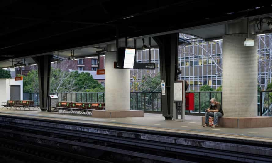 A lone passenger in a face mask waits at the quiet Circular Quay train station during Sydney's Covid-19 lockdown