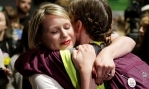 People embrace at the count centre as votes are tallied folowing Ireland's referendum on abortion law