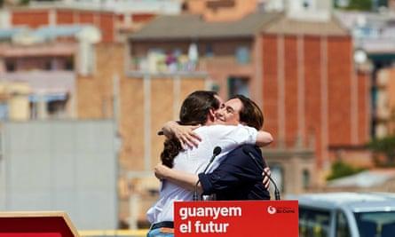 Podemos leader Pablo Iglesias hugs Barcelona mayor Ada Colau.