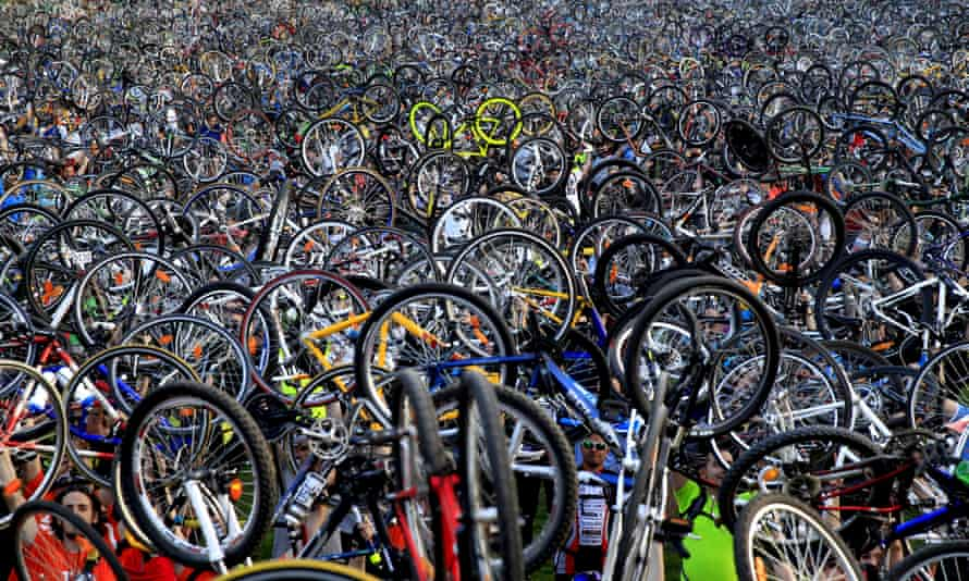 Thousands of cyclists hold up their bicycles after a Critical Mass rise in Budapest.